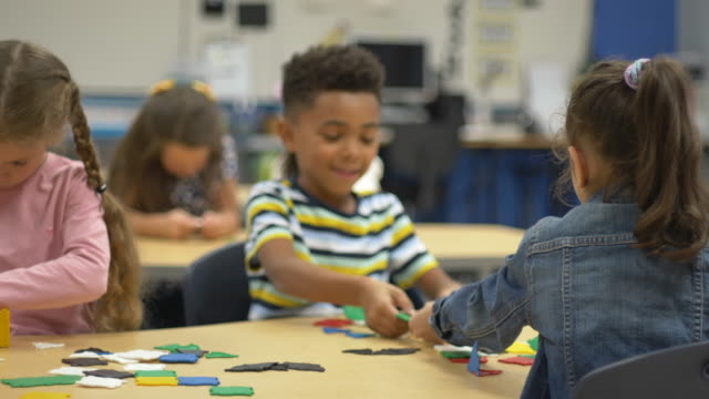 students playing with building toys - sharing stock videos & royalty-free footage
