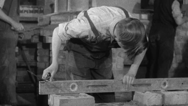 montage students practicing and learning brick laying / london, england, united kingdom - 1944 stock videos & royalty-free footage