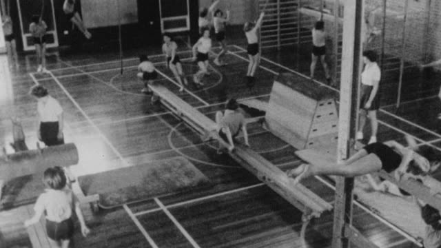 1962 MONTAGE Students practicing gymnastics and playing basketball at Holland Park School / Kensington, London, England