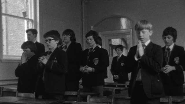 1976 B/W Students praying in classroom / Liverpool, Merseyside, England
