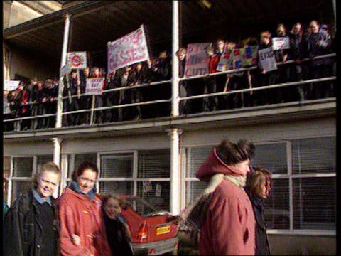 students protest against budget cuts; england: derbyshire: matlock: ext schoolchildren off school bus with placards l-r as along teacher and pupils... - robin day stock videos & royalty-free footage