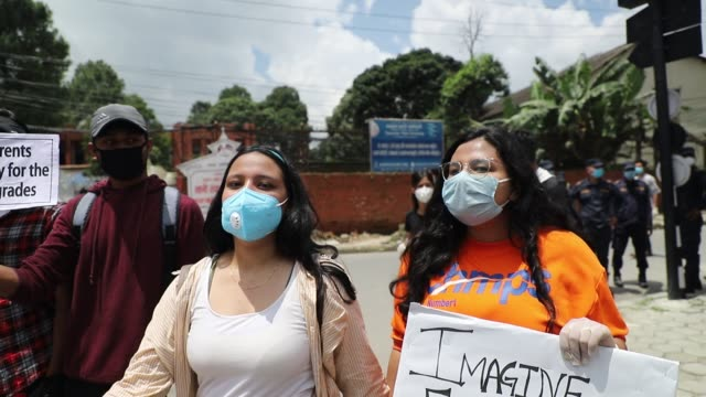 students protest against the cambridge assessment international education results which was published earlier this week in kathmandu nepal on friday... - {{relatedsearchurl(carousel.phrase)}}点の映像素材/bロール