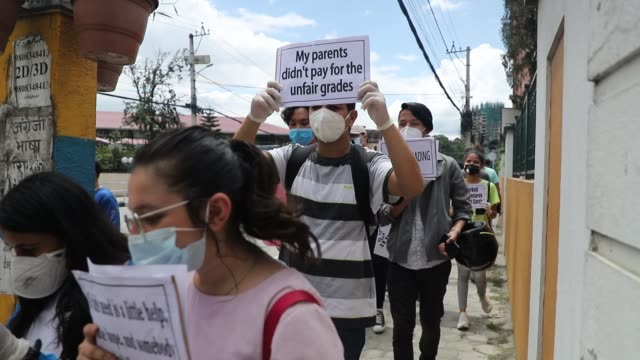 students protest against the cambridge assessment international education results which was published earlier this week in kathmandu nepal on friday... - {{relatedsearchurl(carousel.phrase)}} stock-videos und b-roll-filmmaterial