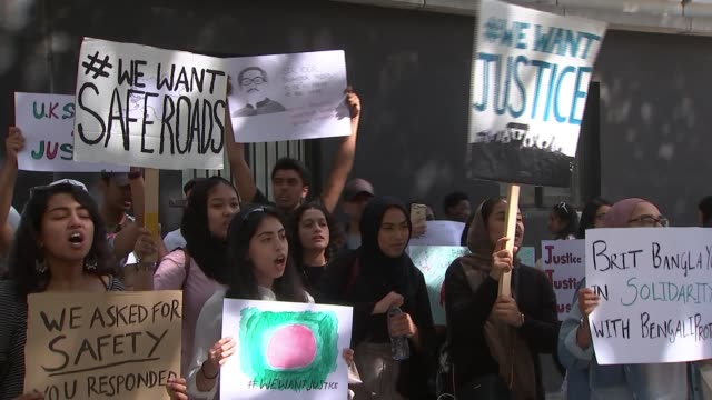 vidéos et rushes de students protest in london over suppression of antigovernment demonstrations england london ext demonstrator chanting sot protesters holding placards... - bangladesh