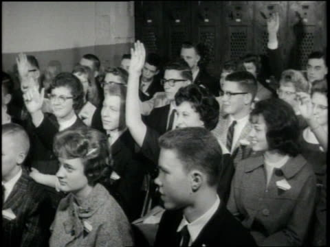 students raise their hands to vote during class. - hand raised stock videos & royalty-free footage