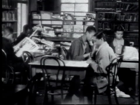 1940 montage students reading in library / alabama, united states - 1940 stock videos and b-roll footage