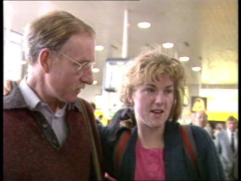 Students return from China b Gatwick Airport CMS Man waving PAN RL girl runs to woman amp hugs CMS Vox Pop female student SOF CMS Vox Pop another...