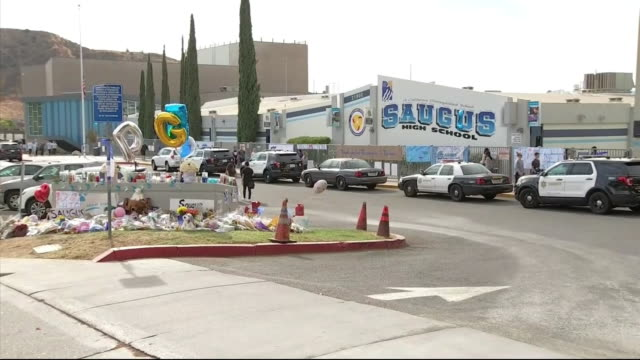 students return to saugus high school following a mass shooting at the school in santa clarita california - santa clarita stock-videos und b-roll-filmmaterial