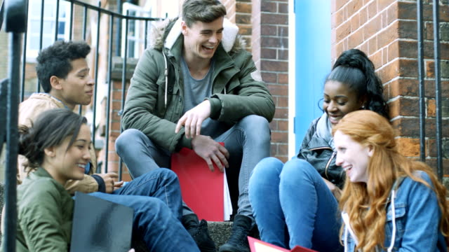 Students sitting on stairs and talking