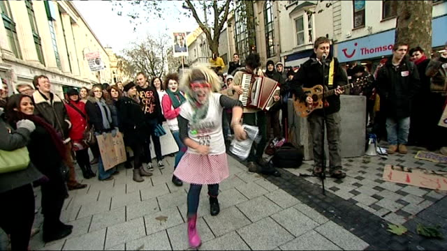 students stage third day of protests against tuition fees rise; wales: cardiff: students cheering and clapping and dancing as celebrate news that... - 3日目点の映像素材/bロール