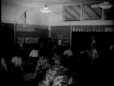 montage b/w ws students standing up in classroom / ms pan children saying pledge of allegiance / usa - pledge of allegiance stock videos & royalty-free footage