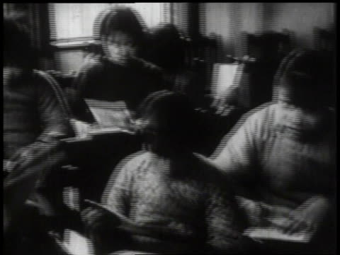 1932 PAN students studying in classroom / China