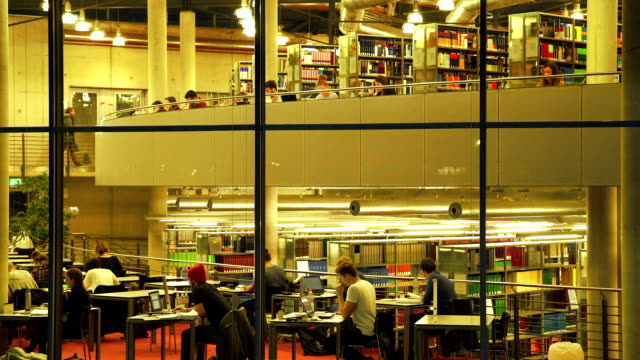Students Studying In The Library At Night