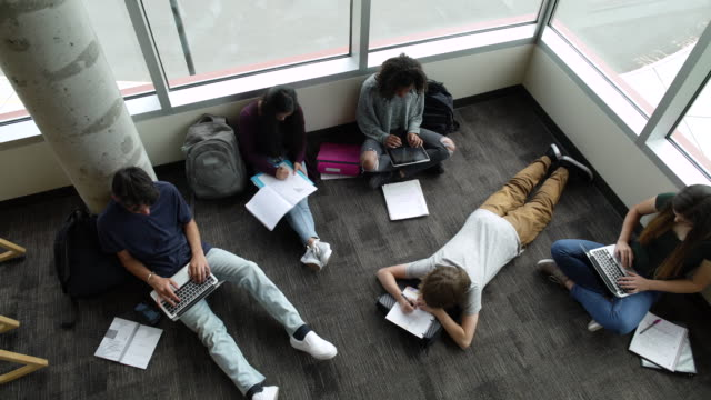 Students studying on floor