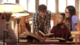 DS Students studying together in the library