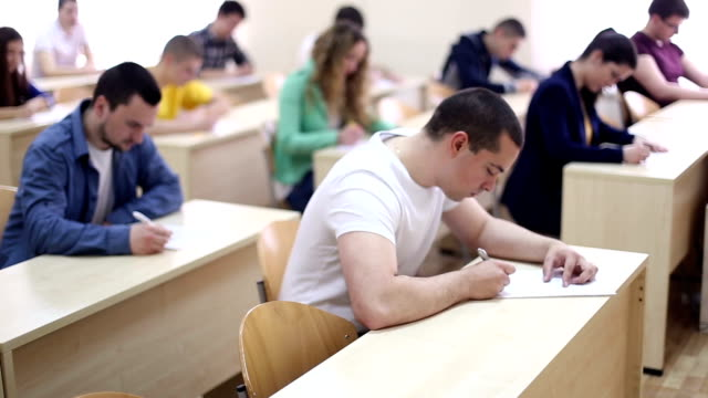 students taking test - educational exam stock videos & royalty-free footage