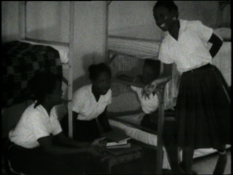 students talk in a dorm room at a boarding school in liberia africa - boarding school stock videos & royalty-free footage