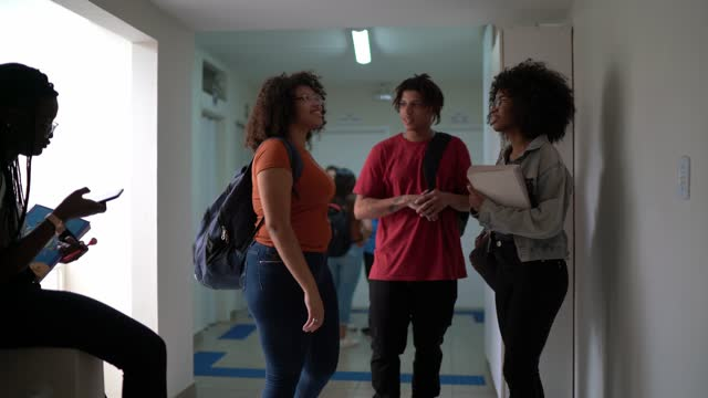 students talking in the school / university corridor - community college stock videos & royalty-free footage