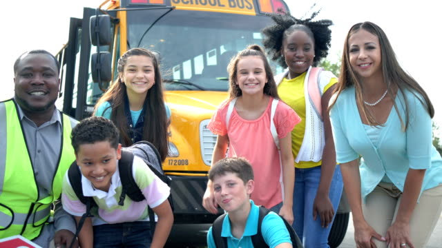 students, teacher, pose in front of school bus - 12 13 years stock videos & royalty-free footage