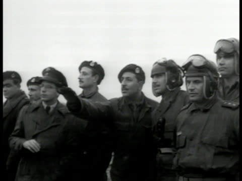 students trainees watching on field pointing talking stationed tanks vs heavy armored tanks on field moving into position taking turns driving on... - 1951 stock-videos und b-roll-filmmaterial