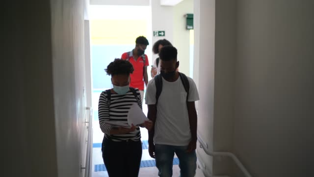 students using note pad at school's corridor - prevention stock videos & royalty-free footage