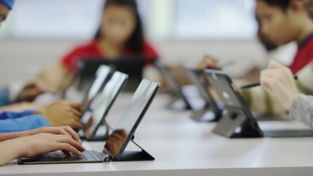 Students using tablets in school