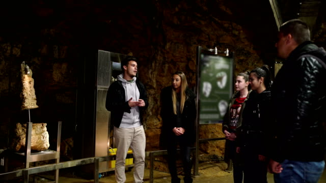 students visit the ancient cave and learning something new - monument stock videos & royalty-free footage