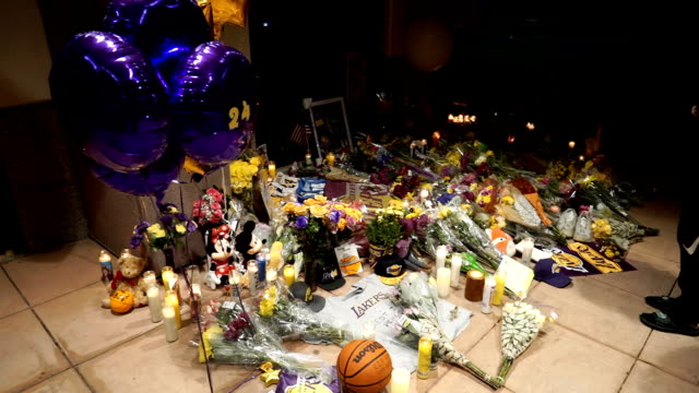 students visit the kobe bryant memorial at the mamba academy in the middle of the night the academy was the destination for the doomed helicopter... - kobe bryant stock videos & royalty-free footage