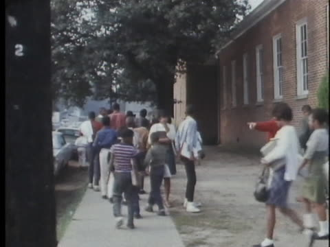 students walk out of a high school in mississippi in 1966. - teenager stock videos & royalty-free footage