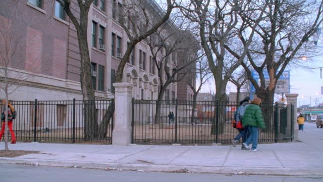 students walk past a brick high school. - brick stock videos & royalty-free footage