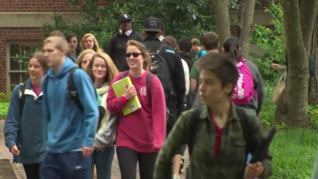 students walking across university campus - university student stock videos & royalty-free footage