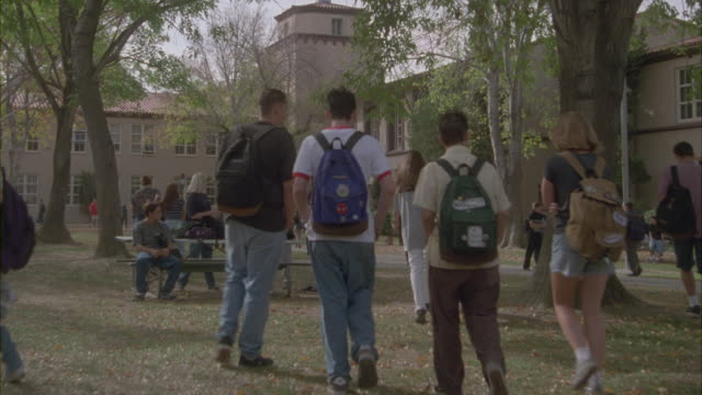 students walking and chatting in a high school courtyard. - female high school student stock videos and b-roll footage