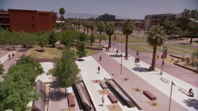 ws students walking around university of arizona quadrangle / tucson, arizona, united states - arizona stock videos & royalty-free footage
