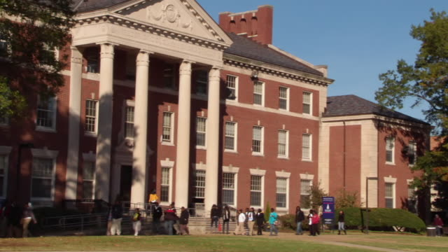 WS ZO Students walking by Frederick Douglass Memorial Hall on Howard University campus / Washington, District of Columbia, United States