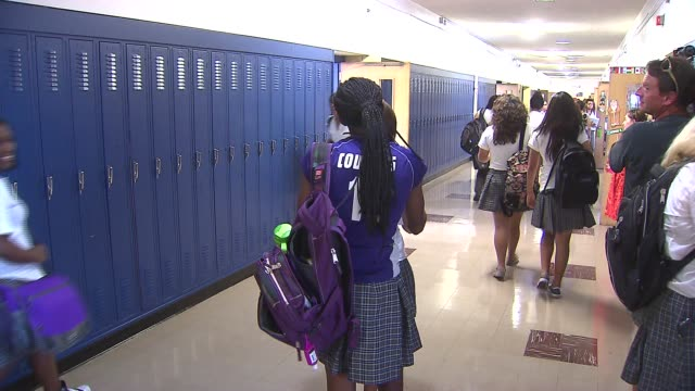 students walking in catholic high school hall at josephinum academy on august 27, 2013 in chicago, illinois - locker stock videos & royalty-free footage