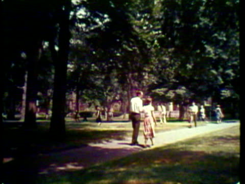 1953 WS PAN TD Students walking in courtyard at Harvard University / Cambridge, Massachusetts, USA / AUDIO