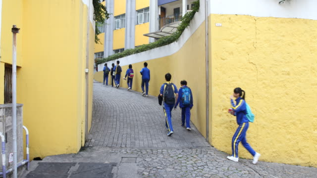 students walking into the colegio mateus ricci jesuit secondary school named after matteo ricci sj who was an italian jesuit priest and one of the... - christian ender stock-videos und b-roll-filmmaterial