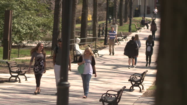 ws pan ha students walking on path through university campus, bethlehem, pennsylvania, usa - see other clips from this shoot 1503 stock videos and b-roll footage