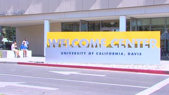 students walking on uc davis campus - university of california stock videos & royalty-free footage