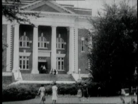 1940 MONTAGE students walking outside a college / Tuskegee, Alabama, United States