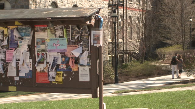 ms students walking past university notice board on path on campus, bethlehem, pennsylvania, usa - school bulletin board stock videos and b-roll footage