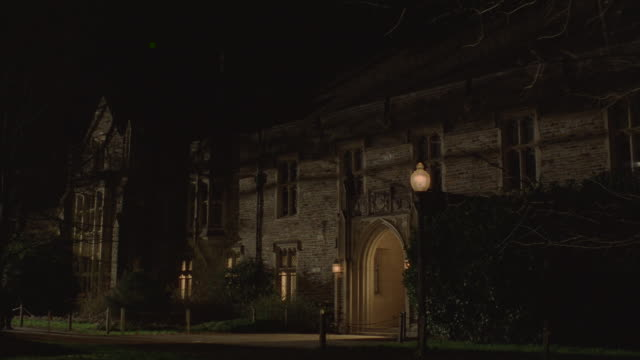 Students walking through the Duke University campus at night.