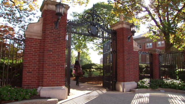 WS Students walking through wrought iron gate on Howard University campus / Washington, District of Columbia, United States