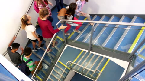 students walking up school staircase - steps and staircases stock videos & royalty-free footage