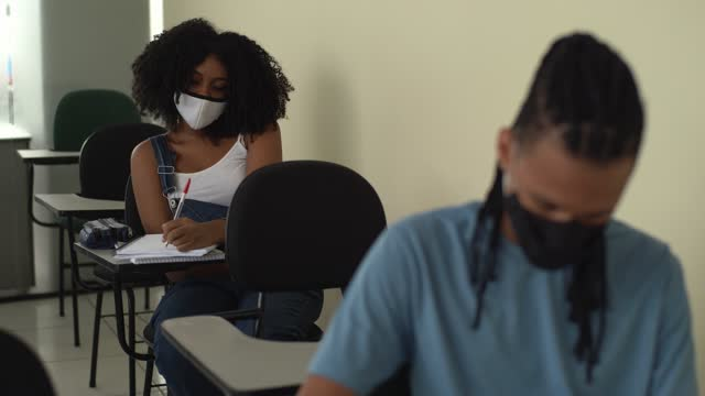 students wearing face mask studying during class at school - prevention stock videos & royalty-free footage