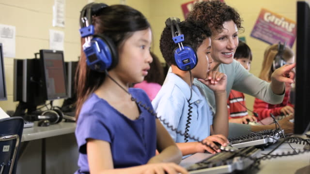 ms students wearing headphones in computer class with teacher / richmond, virginia, united states     - facial expression stock videos & royalty-free footage