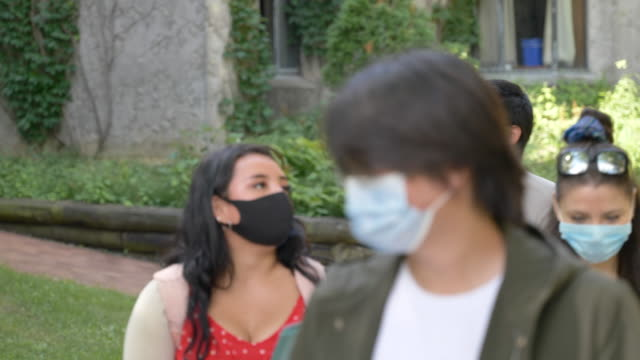 students wearing masks on campus - back to school stock videos & royalty-free footage