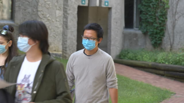 students wearing masks on campus - fatcamera stock videos & royalty-free footage