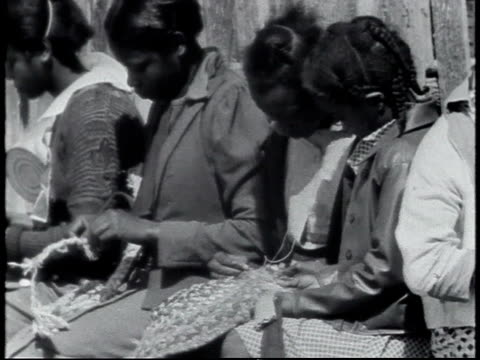 1940 montage students weaving wall hanging or basket, working on a craft project / calhoun, alabama, united states - segregation stock videos & royalty-free footage