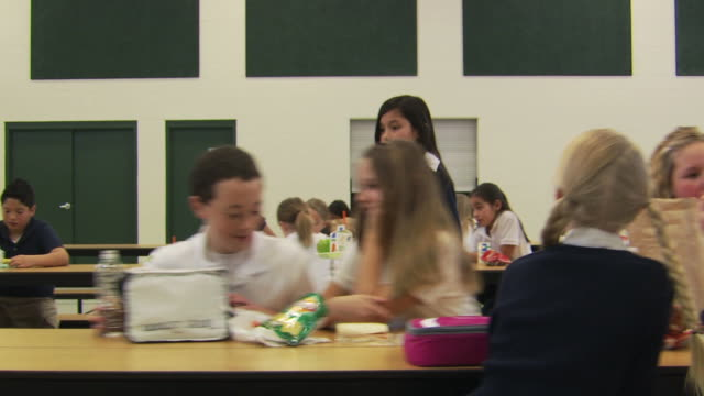 students welcoming a girl at lunch - lunch stock videos & royalty-free footage